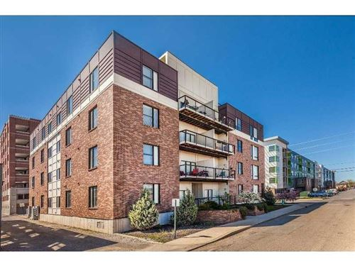 Photo of 721 East NORTH Street #1A, Indianapolis, IN 46202 (MLS # 21710054)