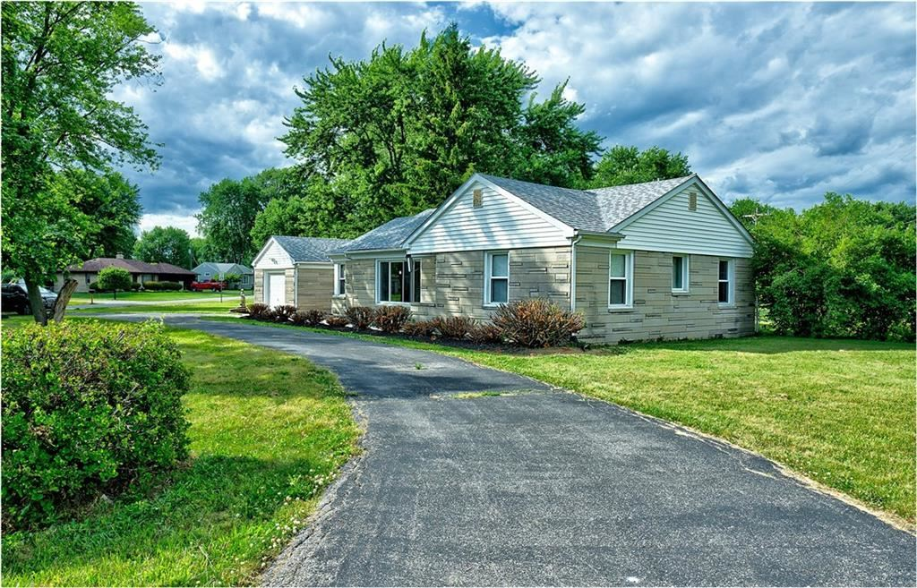Photo of 1410 West Smith Valley Road, Greenwood, IN 46142 (MLS # 21721383)
