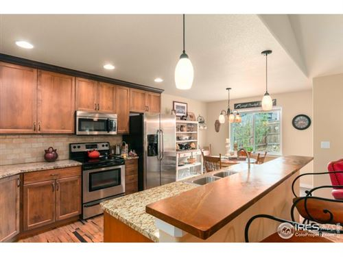 Photo of 484 Heritage Ln, Johnstown, CO 80534 (MLS # 913222)