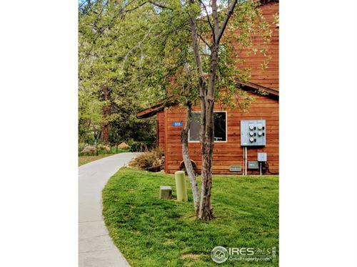 Photo of 509 Fall River Ln 509-C, Estes Park, CO 80517 (MLS # 904404)