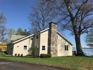 Photo of 809 Farleys Point Road, Union Springs, NY 13160 (MLS # 316861)