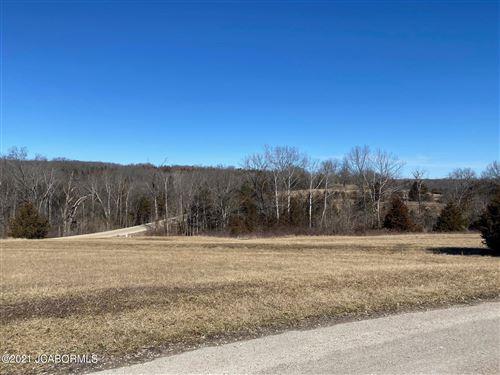 Photo of 620 WHISPERING CEDARS LANE, Jefferson City, MO 65101 (MLS # 10059995)