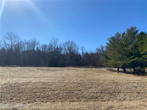 Photo of 517 WHISPERING CEDARS LANE, Jefferson City, MO 65101 (MLS # 10059996)