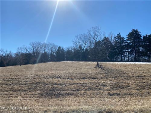 Photo of 613 WHISPERING CEDARS LANE, Jefferson City, MO 65101 (MLS # 10059998)