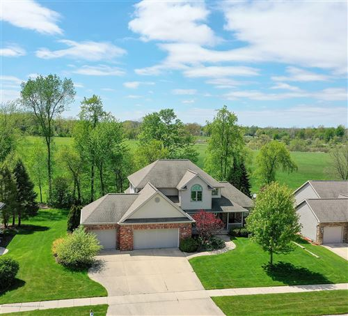 Photo of 10807 Knockaderry Drive, Grand Ledge, MI 48837 (MLS # 246218)