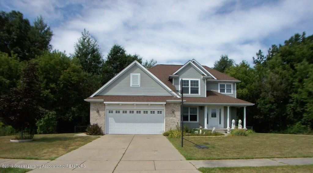 Photo of 411 Perry Lake Drive, Perry, MI 48872 (MLS # 242650)