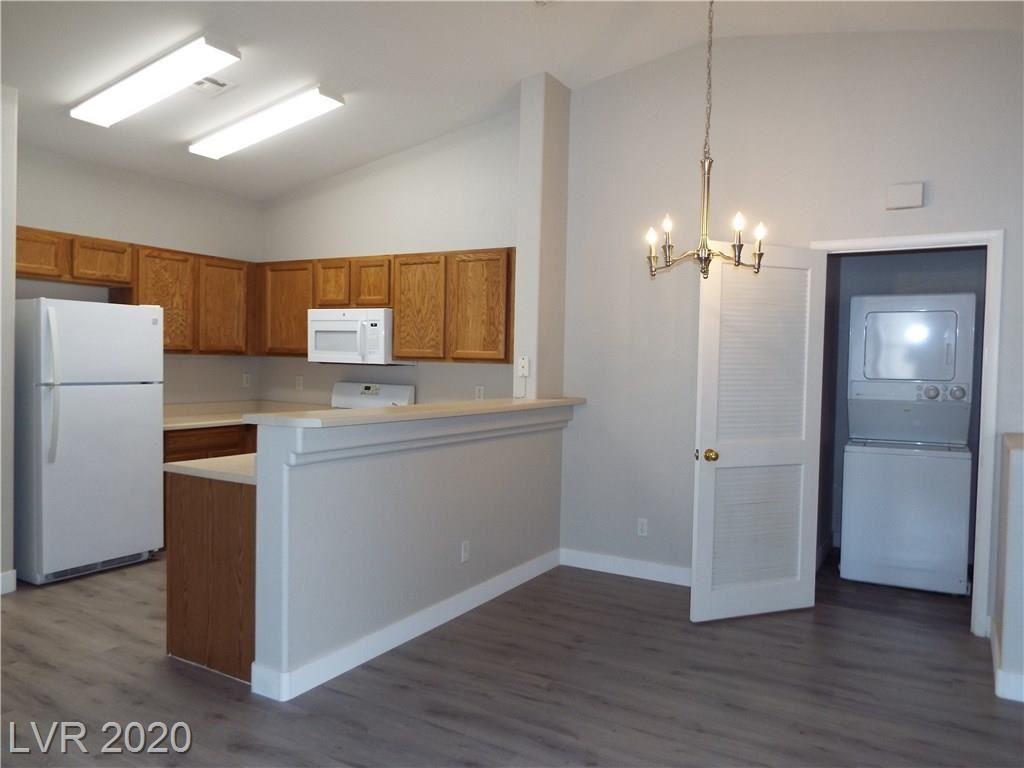 Photo of 6435 Rusticated Stone Avenue #101, Henderson, NV 89011 (MLS # 2234023)