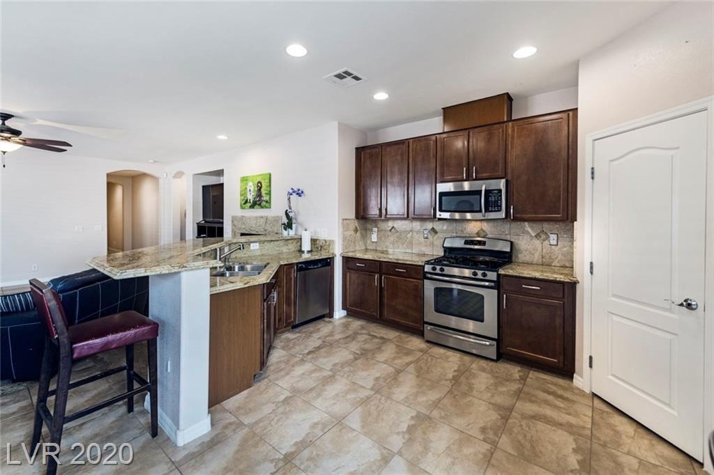 Photo of 10412 Bays Mountain Avenue, Las Vegas, NV 89166 (MLS # 2230255)
