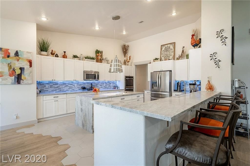 Photo of 7521 Cedar Rae Avenue, Las Vegas, NV 89131 (MLS # 2210261)