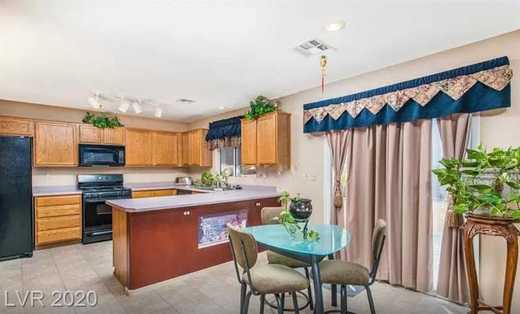 Photo of 3821 Caribbean Blue Avenue, North Las Vegas, NV 89031 (MLS # 2240494)