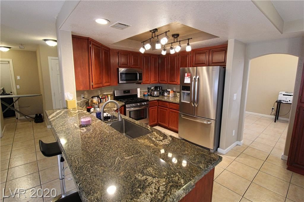 Photo of 7645 TORTOLA BAY Lane, Las Vegas, NV 89129 (MLS # 2169539)