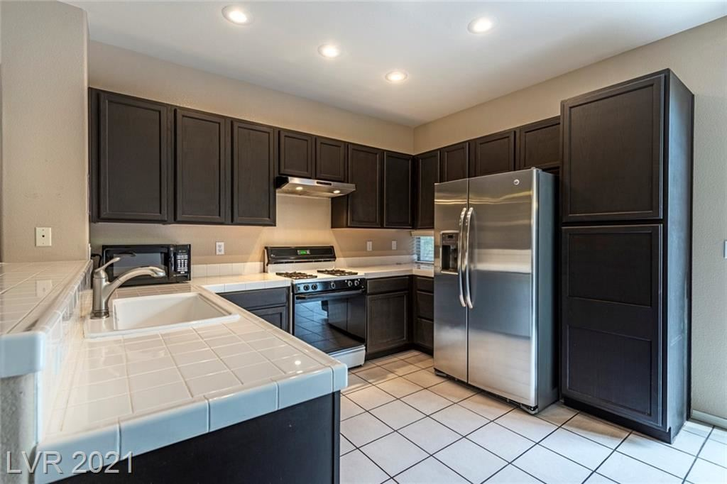 Photo of 10341 Bentley Oaks Avenue, Las Vegas, NV 89135 (MLS # 2329559)