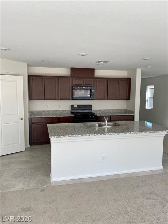 Photo of 1215 Corral Bluffs Avenue, North Las Vegas, NV 89084 (MLS # 2240629)