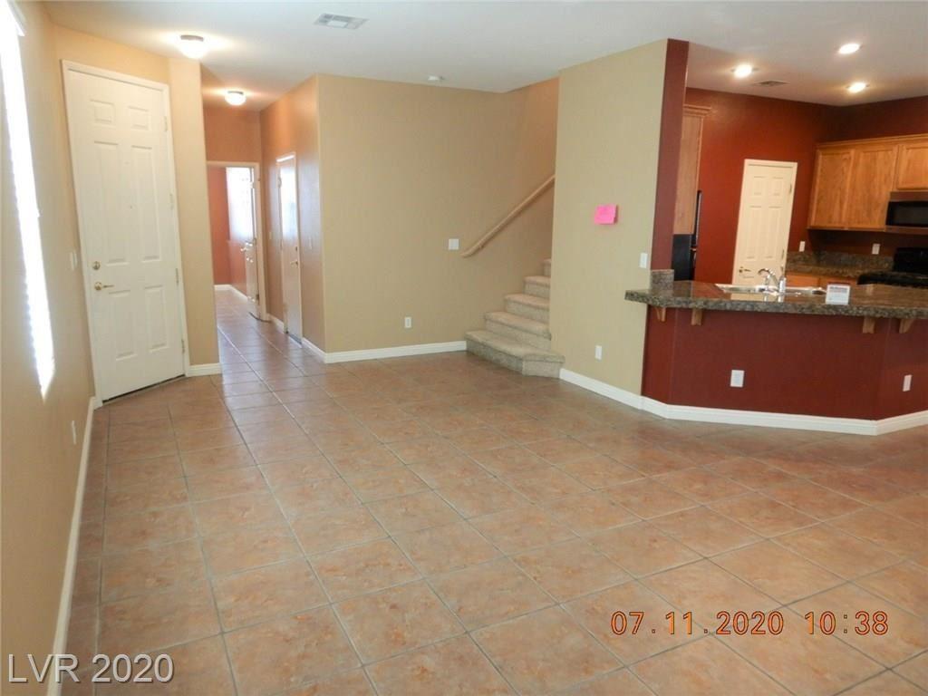 Photo of 9752 CLIFFORD WALK Avenue, Las Vegas, NV 89148 (MLS # 2210664)