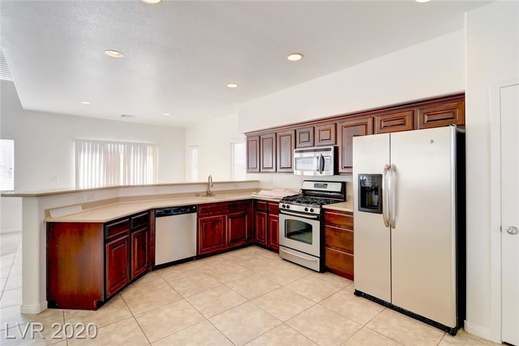 Photo of 5217 SPICEBUSH Street, North Las Vegas, NV 89081 (MLS # 2210721)