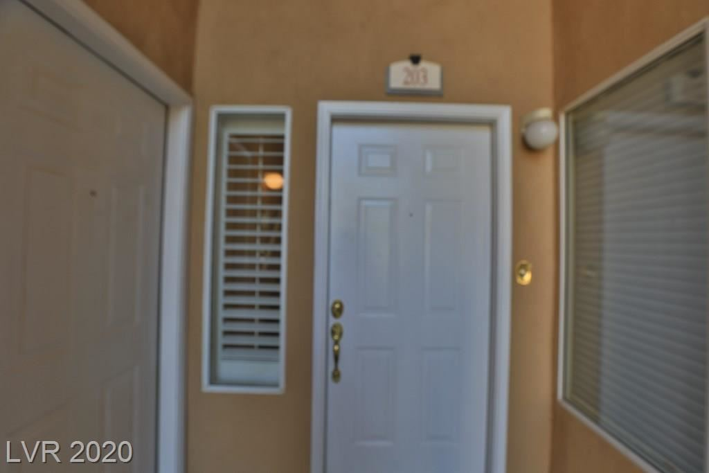 Photo of 1700 Sky Of Red Drive #203, Las Vegas, NV 89128 (MLS # 2224885)