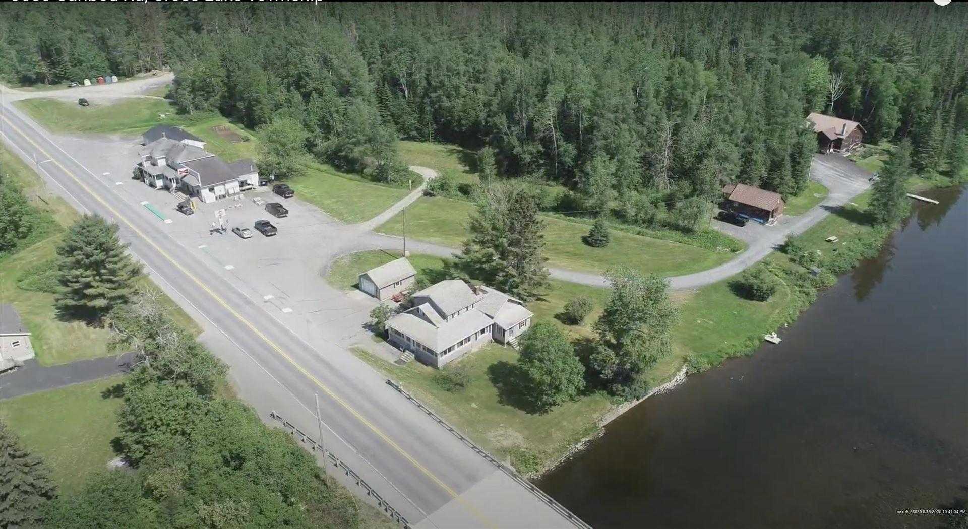 Photo of 3580 Caribou Road, Cross Lake Township, ME 04779 (MLS # 1457334)