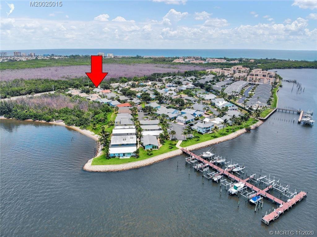 Photo of 4140 NE Breakwater Drive, Jensen Beach, FL 34957 (MLS # M20025015)