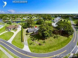Photo of 774 NW Spruce Ridge Drive, Stuart, FL 34994 (MLS # M20026286)
