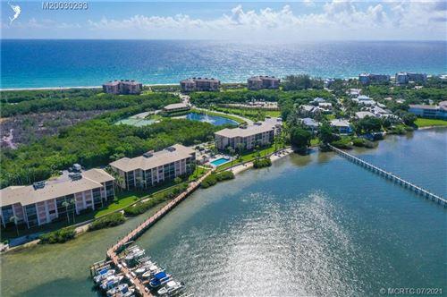 Photo of 4720 NE Sandpebble Trace #101, Stuart, FL 34996 (MLS # M20030293)