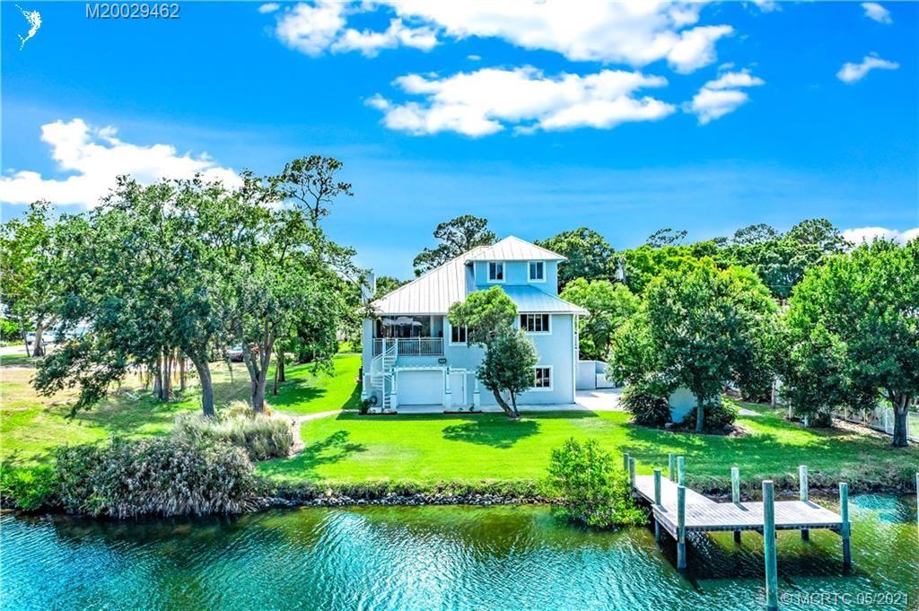 Photo of 961 SW Pine Tree Lane, Palm City, FL 34990 (MLS # M20029462)