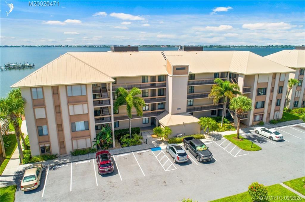 Photo of 4680 NE Sandpebble Trace #404, Stuart, FL 34996 (MLS # M20025471)