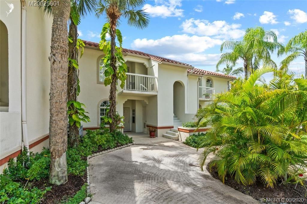 Photo of 209 Cypress Point Drive, Palm Beach Gardens, FL 33418 (MLS # M20025601)