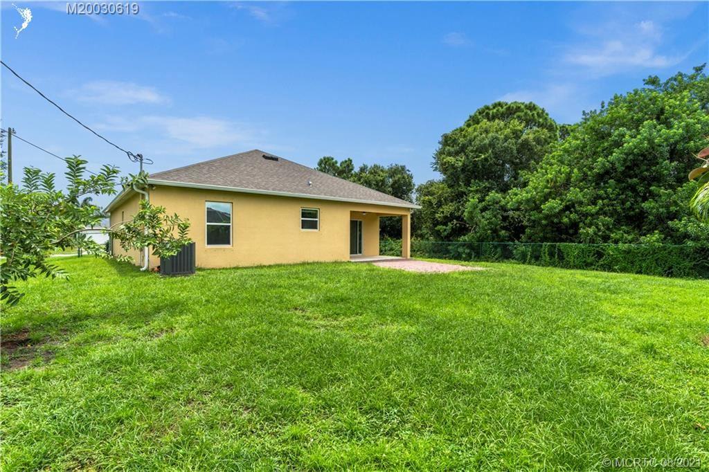 Photo of 1673 SW Meridian Avenue, Saint Lucie West, FL 34953 (MLS # M20030619)