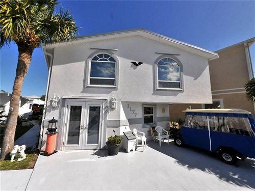 Photo of 1177 Nettles Blvd, Jensen Beach, FL 34957 (MLS # M20016870)