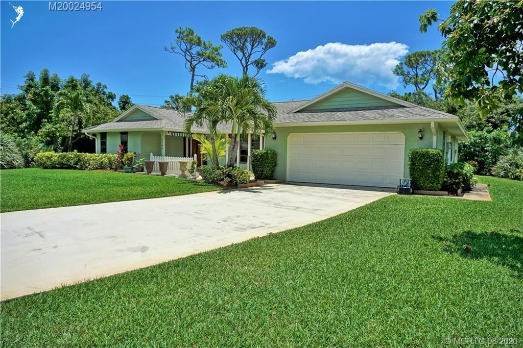 Photo of 2143 NE Marlberry Lane, Jensen Beach, FL 34957 (MLS # M20024954)