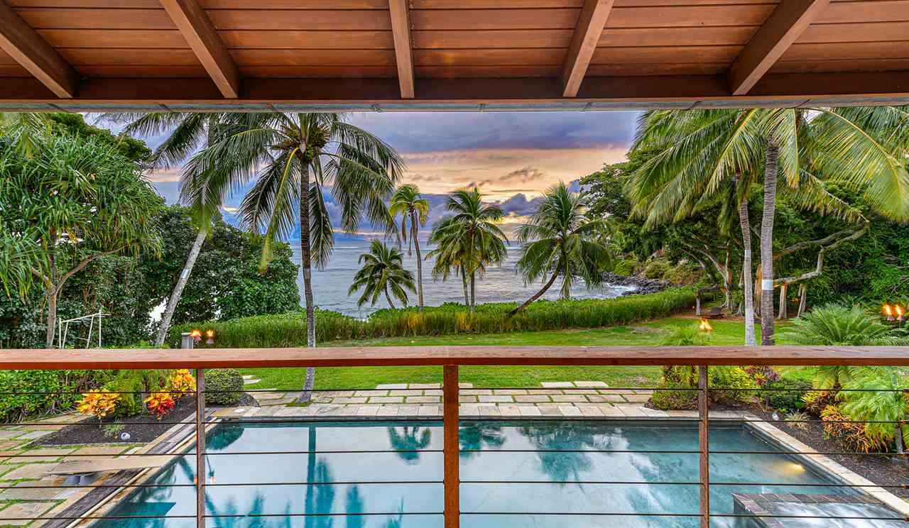 Photo of 22 Wa'a Pl, Paia, HI 96779-9741 (MLS # 389010)