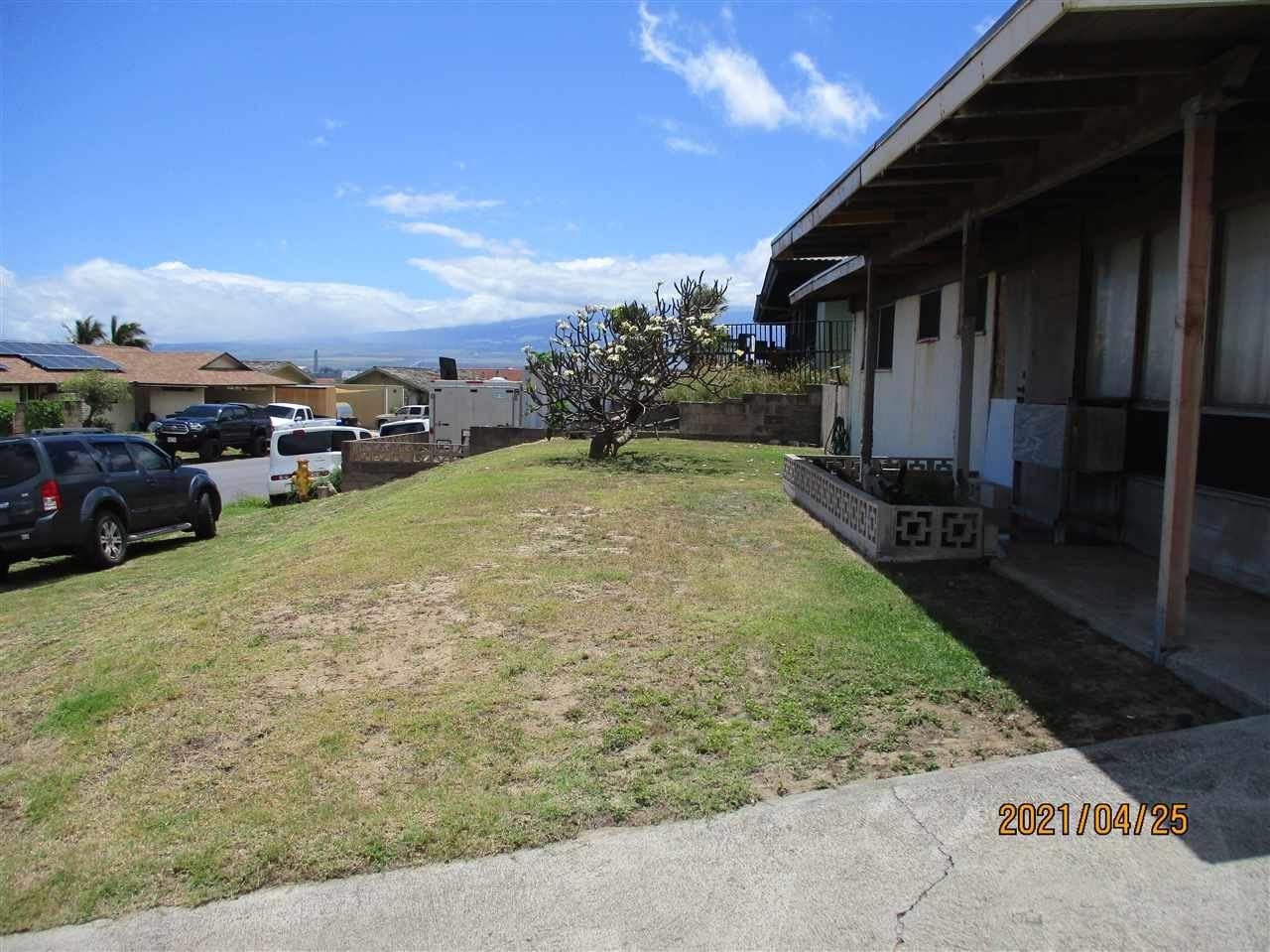 Photo of 654 Pio Dr, Wailuku, HI 96793 (MLS # 391254)