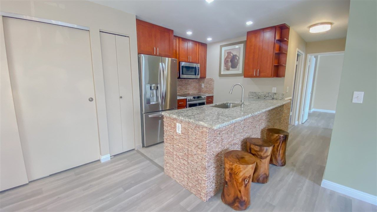 Photo of 480 Kenolio Rd #28-201, Kihei, HI 96753 (MLS # 387432)