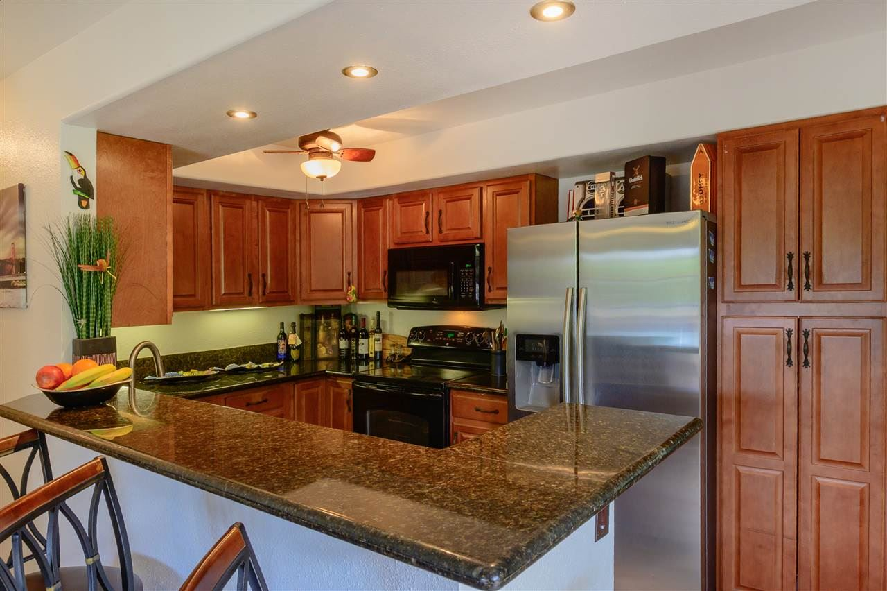 Photo of 140 UWAPO Rd #15-106, Kihei, HI 96753 (MLS # 386434)