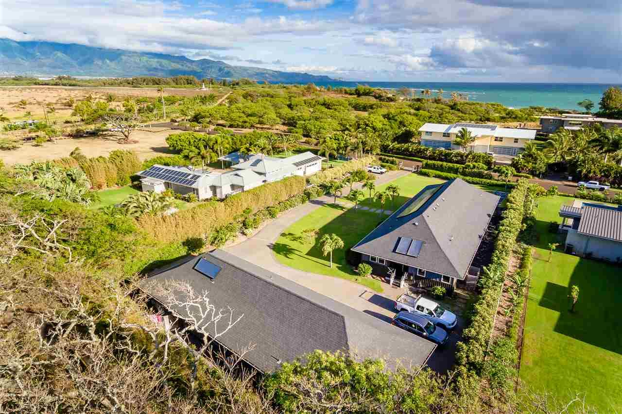 Photo of 1030 Kapukaulua Pl, Paia, HI 96779 (MLS # 387557)
