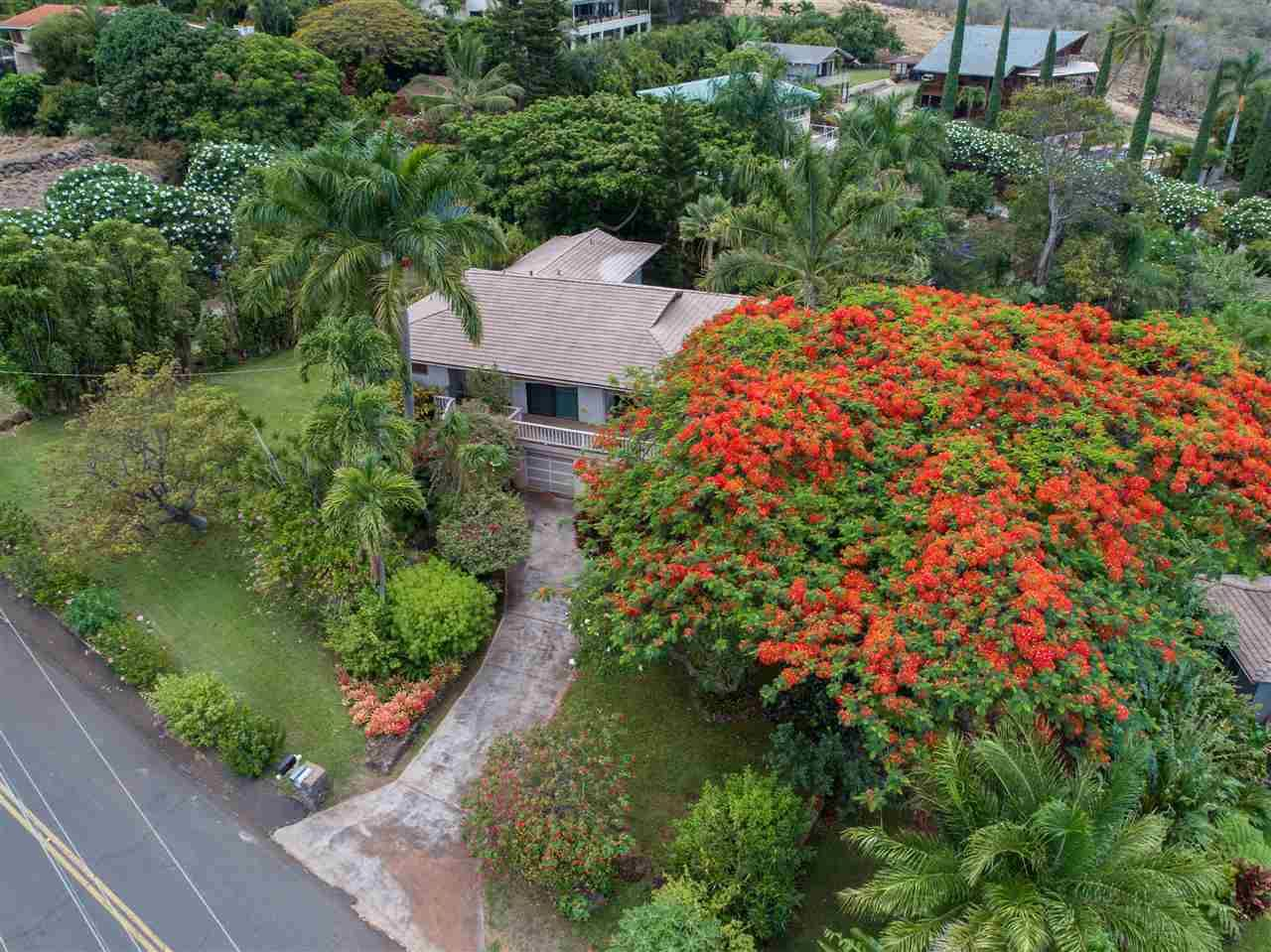 Photo of 688 Kumulani Dr, Kihei, HI 96753 (MLS # 387670)