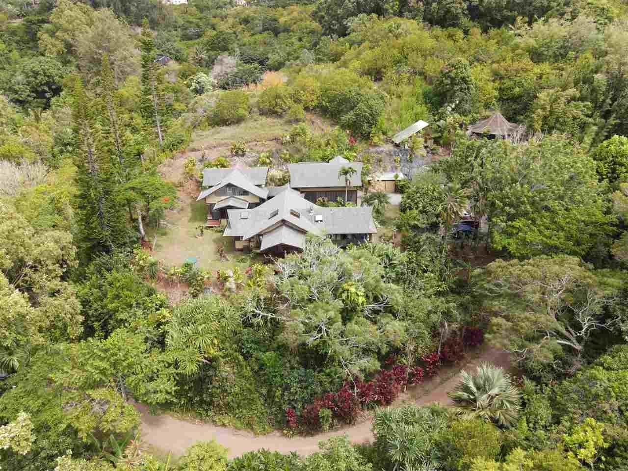 Photo of 680 E Kuiaha Rd, Haiku, HI 96708 (MLS # 387963)