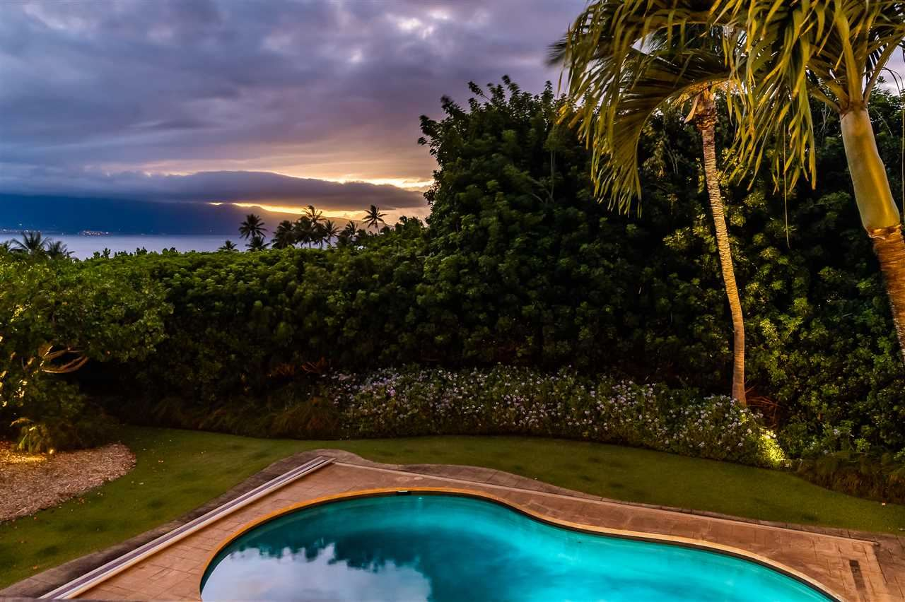 Photo of 115 Kuau Beach Pl, Paia, HI 96779 (MLS # 390977)