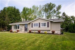 Photo of 210 W Bridge St, Grafton, WI 53024 (MLS # 1643039)