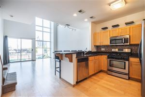 Photo of 2121 S Kinnickinnic Ave #103, Milwaukee, WI 53207 (MLS # 1663176)