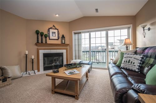 Photo of N16W26555 Tall Reeds LN #H, Pewaukee, WI 53072 (MLS # 1668428)