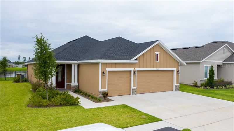 Photo of 17969 PASSIONFLOWER CIRCLE, CLERMONT, FL 34714 (MLS # O5869005)