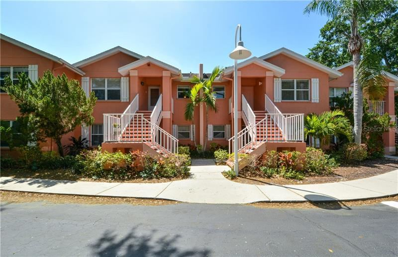 Photo of 5500 LONGWOOD RUN BOULEVARD #203, SARASOTA, FL 34243 (MLS # A4495014)