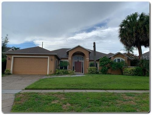 Photo of 8491 ISLAND PALM CIRCLE, ORLANDO, FL 32835 (MLS # O5881020)
