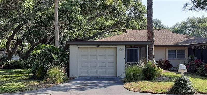 Photo of 7111 GREY SQUIRREL BOULEVARD #13, SARASOTA, FL 34231 (MLS # A4462021)