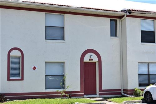 Photo of 1623 SANDY POINT SQ #62, ORLANDO, FL 32807 (MLS # O5878027)