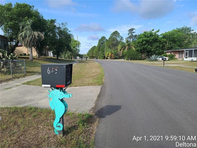 Photo of 665 N WELLINGTON DRIVE, DELTONA, FL 32725 (MLS # O5941034)