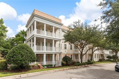 Photo of 7507 MOURNING DOVE CIRCLE #103, REUNION, FL 34747 (MLS # O5867036)