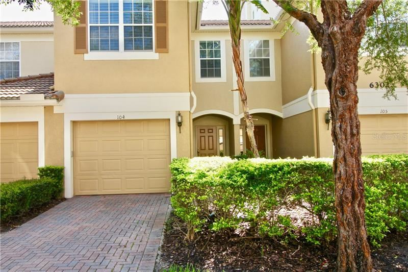 Photo of 6302 DAYSBROOK DRIVE #104, ORLANDO, FL 32835 (MLS # O5883039)