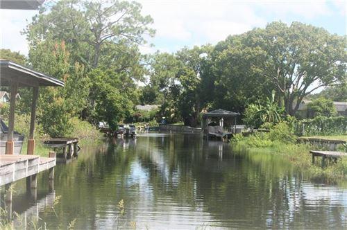 Photo of 8601 LSU LANE, ORLANDO, FL 32817 (MLS # O5876043)